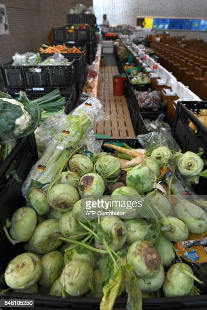 Food and hygiene items donated by supermarkets are pictured at a counter of the 'Duesseldorfer Tafel' in a church in DuesseldorfGarath western...