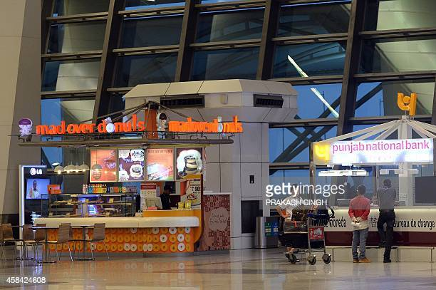 Food and service kiosks at the departure hall at Terminal 3 of Indira Gandhi International airport in New Delhi on November 5 2014 AFP PHOTO/ Prakash...