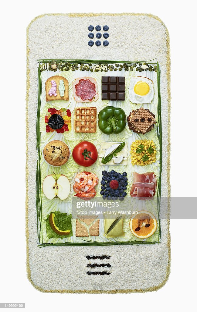 Food arranged in the form of a smart phone : Stock Photo