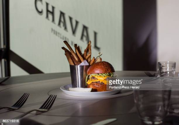 Food at Chaval restaurant in Portland Burger with black pepper beef tallow brioche double local beef patties tomato mustard lettuce american cheeze...