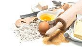 Food background. Baking ingredients flour, eggs, yeast, sugar, butter. Wooden kitchen utensils