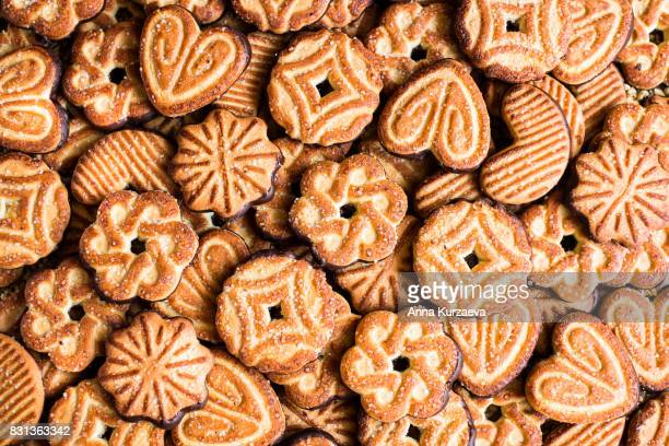 Food background with cookies with sugar and dark chocolate glaze, top view