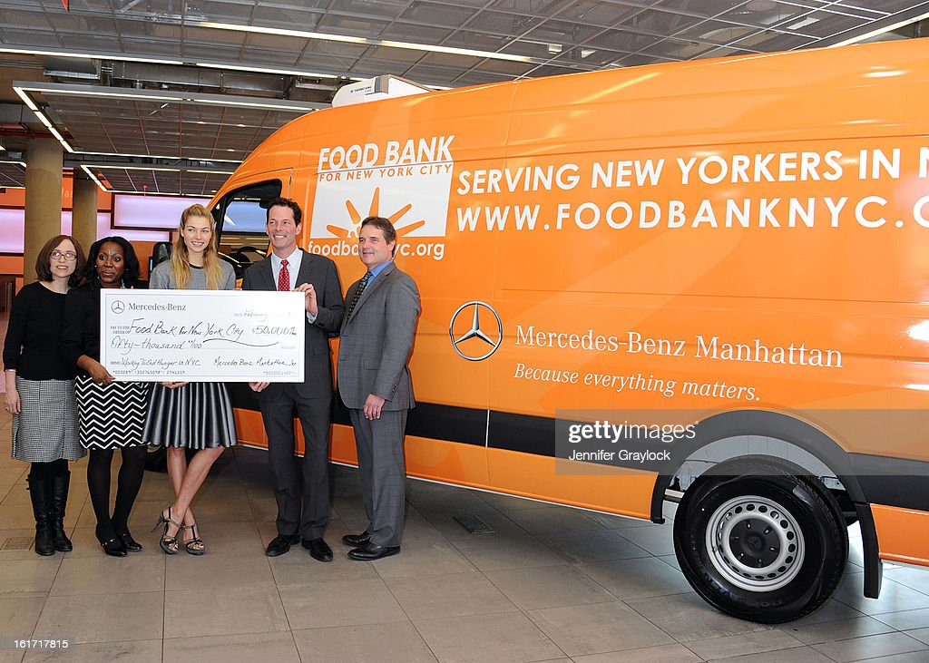 CDO Food Bank for New York City Alyssa Herman, CEO and President Food Bank for New York City Margarette Purvis, Model Jessica Hart, General Manager Mercedes-Benz Manhattan Blair Creed and General Sales Manager Mercedes-Benz ManhattanTom Shanley unveils the Food Bank For New York City's Sprinter Van Donated By Mercedes-Benz Manhattan at the Mercedes-Benz 11th avenue on February 14, 2013 in New York City.