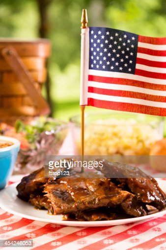 Food:  BBQ ribs, beans, potato salad and an American flag. : Stock Photo