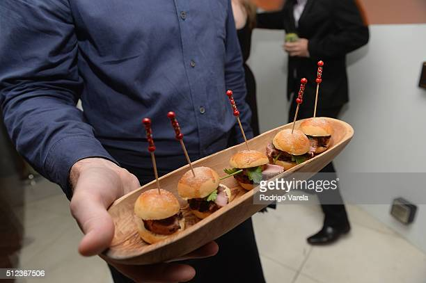 Food being served at a Dinner Hosted By Francis Mallmann And Paul Qui during 2016 Food Network Cooking Channel South Beach Wine Food Festival...