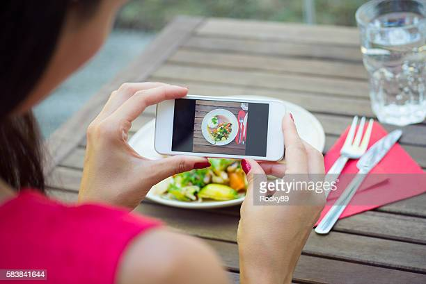 Food Blogger Taking Photos of her Asian Food