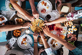 Food Catering Cuisine Culinary Gourmet Party Cheers Concept friendship and dinner together. mobile phones on the table, pattern and background colorful image with people eating and taking food during