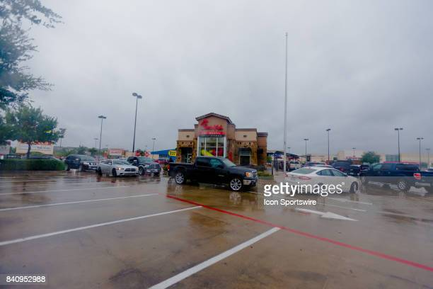 Food chain Chickfila open their drive thru lanes for customers lined up around the restaurant during Hurricane Harvey Monday August 29 2017