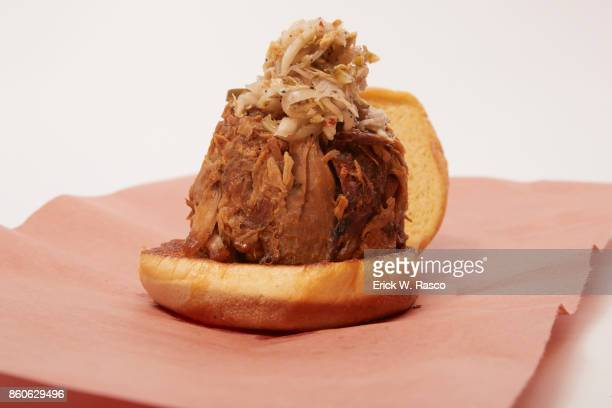 Closeup of pulled pork sandwich on potato roll from Hill Country Barbecue Market during photo shoot at Madison Square Garden New York NY CREDIT Erick...