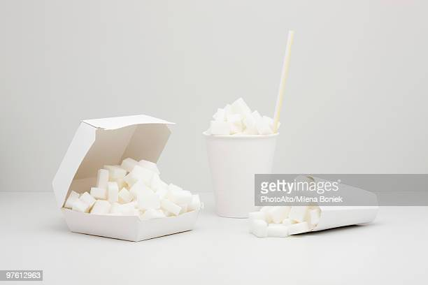 Food concept, sugar cubes inside fast food containers