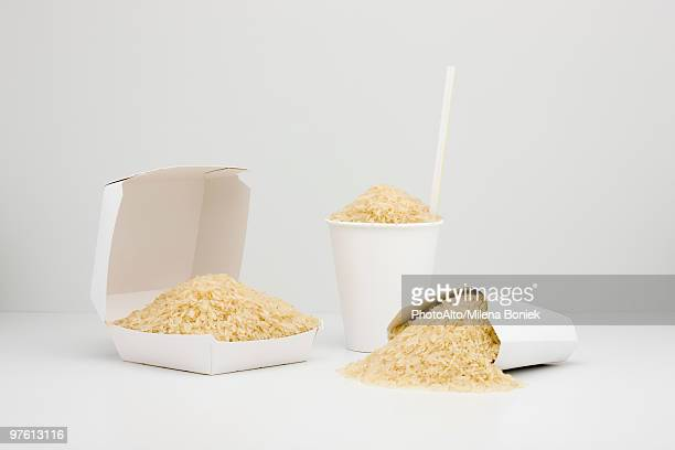 Food concept, uncooked rice inside fast food containers