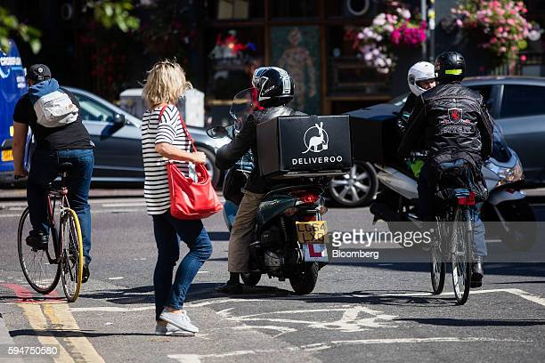 A food delivery box sits on the back of a Deliveroo operated by Roofoods Ltd driver's scooter at a junction in London UK on Monday Aug 22 2016 The...