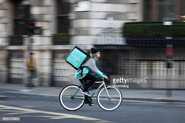 A food delivery cycle courier for Deliveroo operated by Roofoods Ltd travels in London UK on Thursday Dec 22 2016 The food delivery business model...