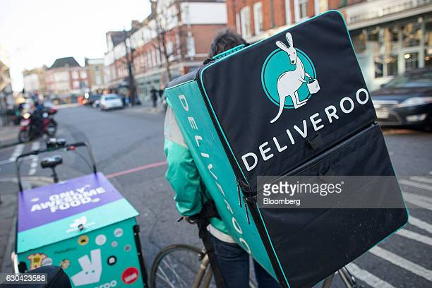 A food delivery cycle courier waits for orders from Deliveroo operated by Roofoods Ltd in London UK on Thursday Dec 22 2016 The food delivery...