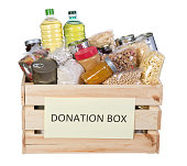 Food donations in a wooden box isolated on white background