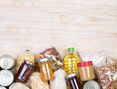 Food samples that can be donated  on wooden background, top view with copy space