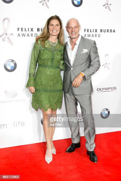 Food expert Sarah Wiener and German actor Simon Licht attend the Felix Burda Award 2017 at Hotel Adlon on May 14 2017 in Berlin Germany