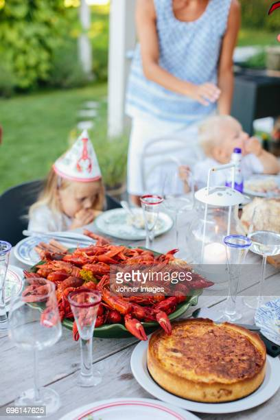 Food for crayfish party with family in background