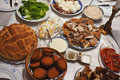 A lot of celebrity food on the table, a celebration called Slava in Serbia.