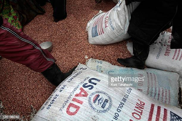 Food from USAID is distributed April 23 2010 in the Mpati Internally Displaced Persons camp about 100km northwest of Goma Democratic Republic of...