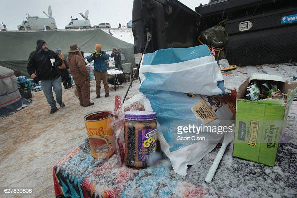 Food gets covered by snow as it sits on a truck tailgate in one of the military veteran camps at Oceti Sakowin Camp on the edge of the Standing Rock...