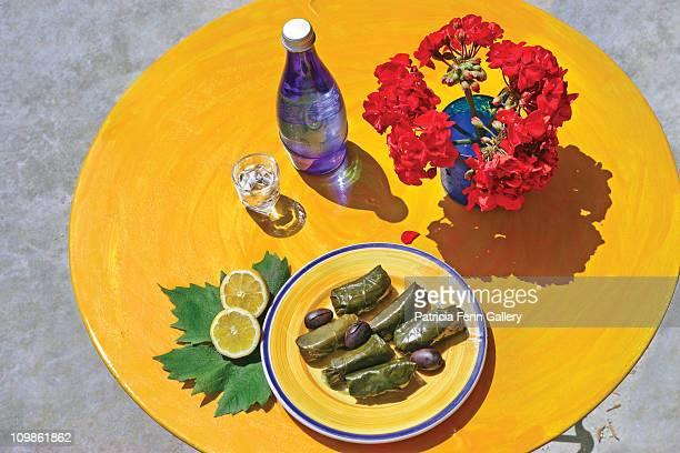 Food. Greece, Dolmades, olives and raki