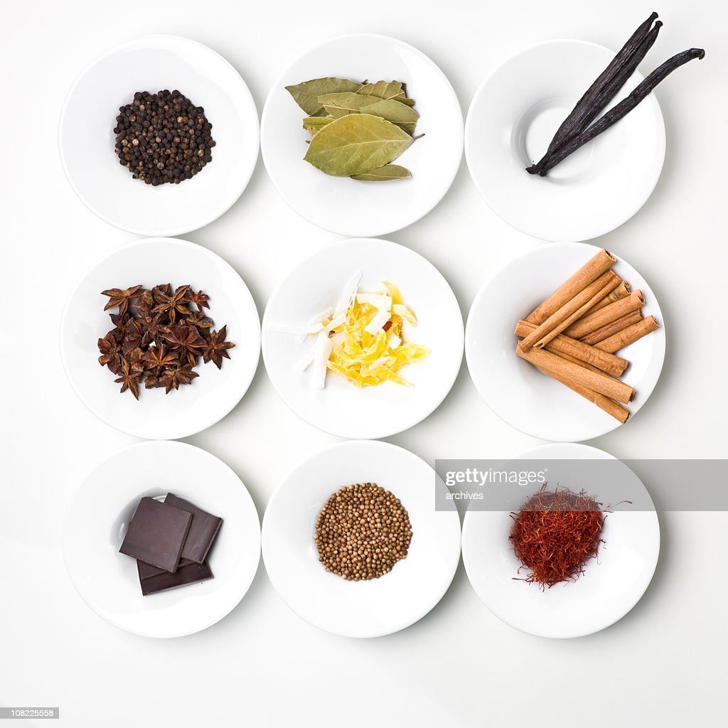 Food Ingredients and Spices Organized on White Plates : Stock Photo