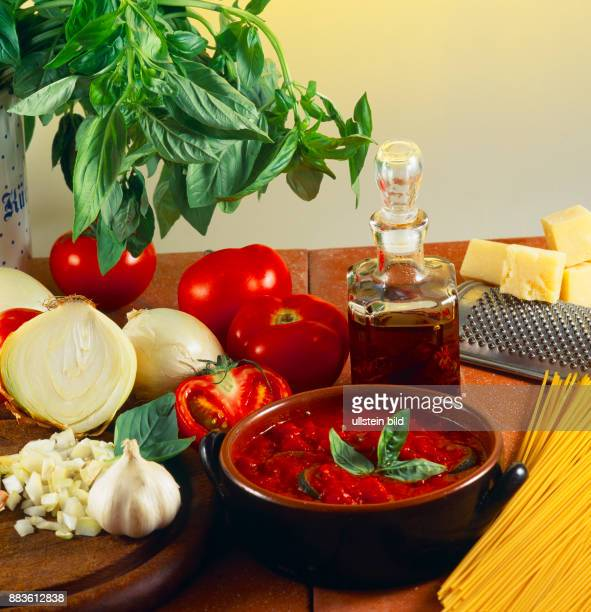 Food Ingredients for tomato sauce onion tomato garlic and olive oil