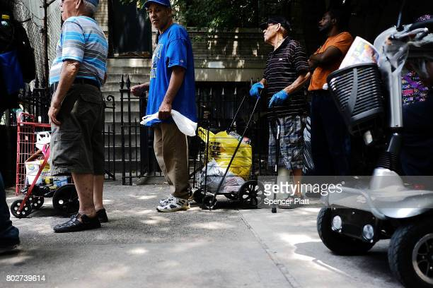 Food is handed out at a street food pantry following the release of a report that says poverty has increased on June 28 2017 in the Bronx borough of...