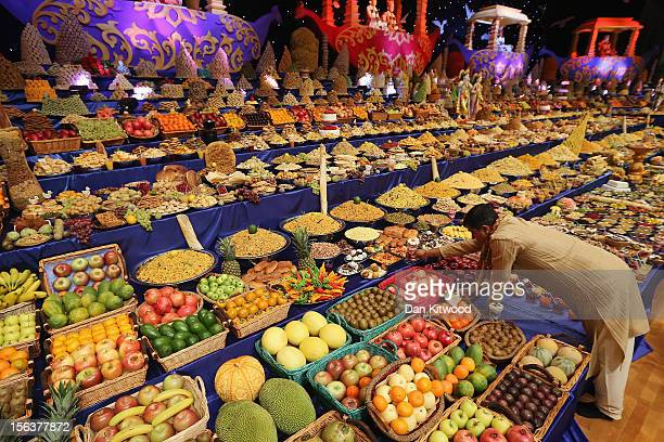 Food is placed on the main stage as Sadhus and Hindu men celebrate Diwali at the BAPS Shri Swaminarayan Mandir on November 14 2012 in London England...