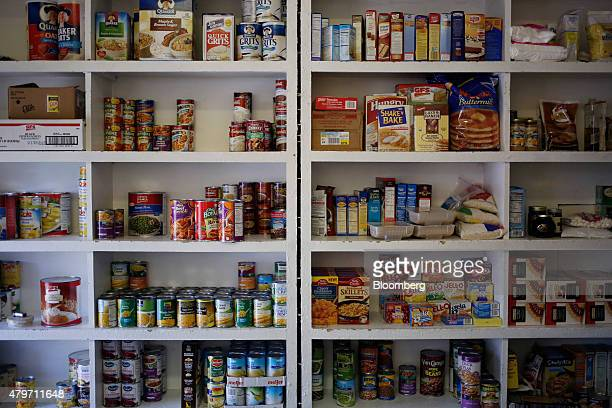 Food is stacked inside the pantry at the Catholic Action Center a charity soup kitchen for impoverished and homeless persons in Lexington Kentucky US...