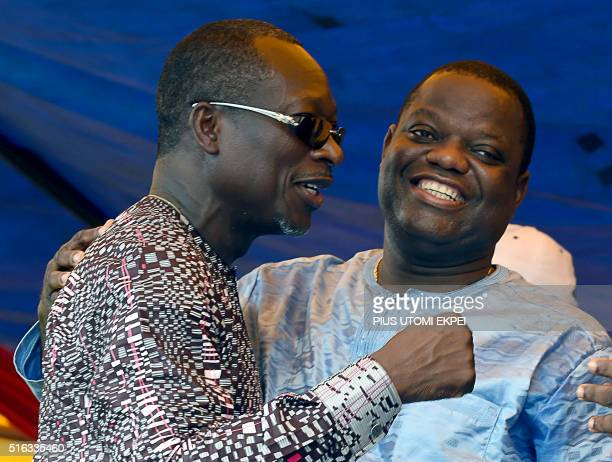 Food magnate and third place runner Sebastien Ajavon hugs Benin presidential candidate and leader of coalition of the opposition Patrice Talon during...