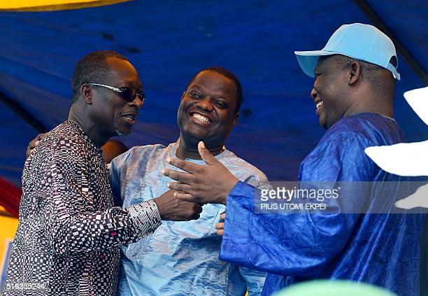 Food magnate and third place runner Sebastien Ajavon hugs presidential candidate and leader of coalition of the opposition Patrice Talon flanked by...