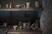 Food materials are pictured in a food storeroom on an underground gallery of a Spanish civil war era bomb shelter in Almeria on May 23 2016 There...