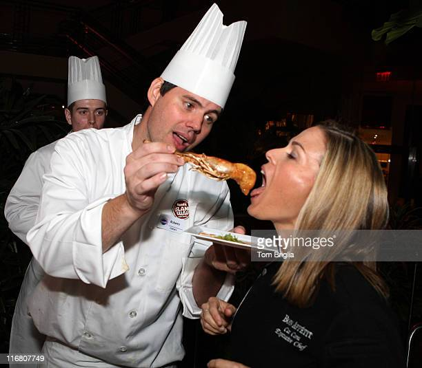Food Network's Star Chef Cat Cora is fed a schrimp at the Splash Party in the new Pool at Harrah's Atlantic City the party kicked off a two day food...