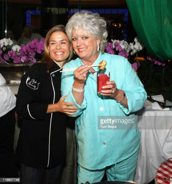 Food Network's Star Chefs Cat Cora and Paula deen share a little bite to eat at the Splash Party in the new Pool at Harrah's Atlantic City the party...