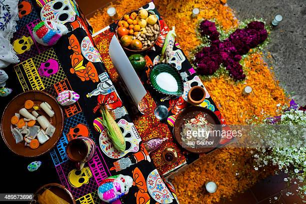 Food offerings are placed at the altar of the dead a religious site honoring the deceased during the Day of the Dead celebration on November 01 2014...