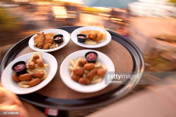 Food on a tray being delivered to tables