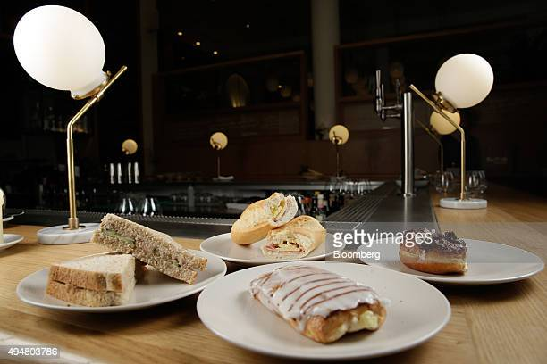 Food products from Greggs Plc's left to right Tuna Mayonnaise and Cucumber sandwich Ham and Cheese baguette Apple Danish and a Triple Chocolate...
