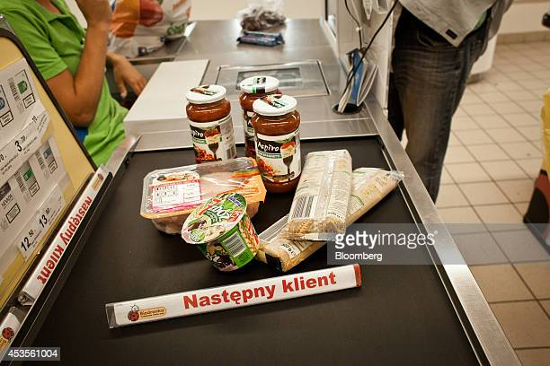 Food products pass along a conveyor belt at the checkout desk of a Biedronka supermarket operated by Jeronimo Martins SGPS SA in Warsaw Poland on...