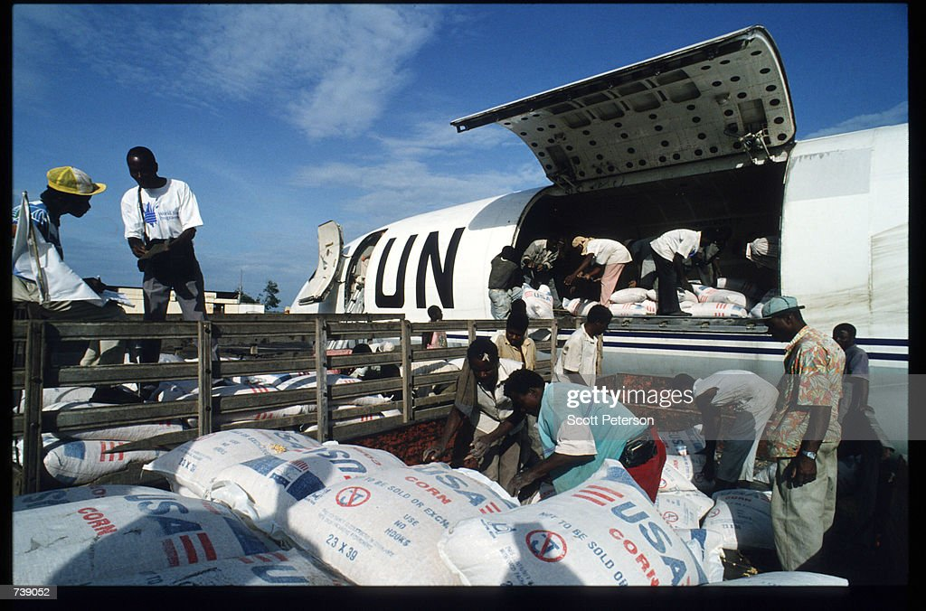 Food relief is unloaded from a United Nations plane February 12 1994 in Malange Angola In wartorn Angola the town of Malange is home to three hundred...