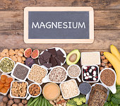 Food rich in magnesium, top view with a small blackboard