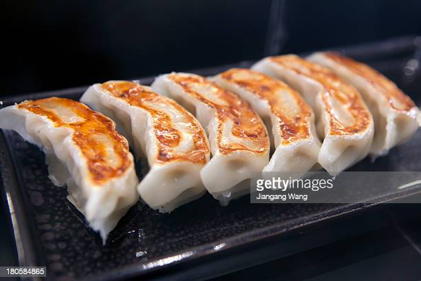 CONTENT] Food sample of panfried Chinese dumplings displayed in a Chinese restaurant In Japan the most popular preparation method to cook Chinese...