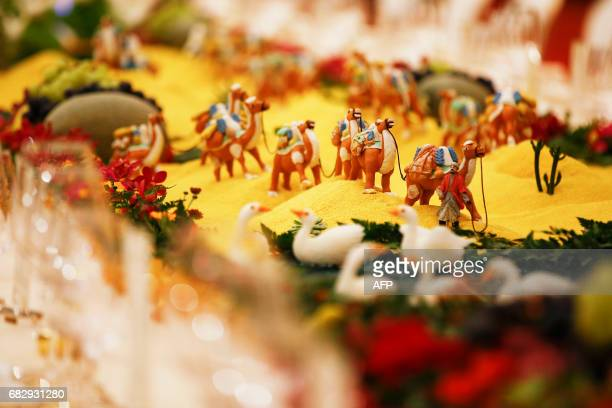 Food sculptures are pictured before the welcoming banquet of the Belt and Road Forum in Beijing's Great Hall of the People on May 14 2017 China...