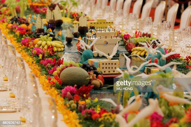 Food sculptures are placed on the table ahead a welcome banquet for the Belt and Road Forum at the Great Hall of the People in Beijing on May 14 2017...