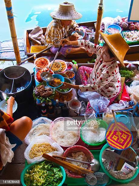 Food sellers in Damnoen Saduak floating market.