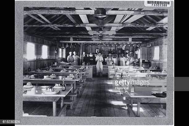 Food service workers stand in the mess hall at the Quartz Creek ERA camp in Kaniksu National Forest Idaho