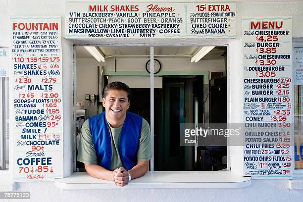 Food Stand Owner at Window