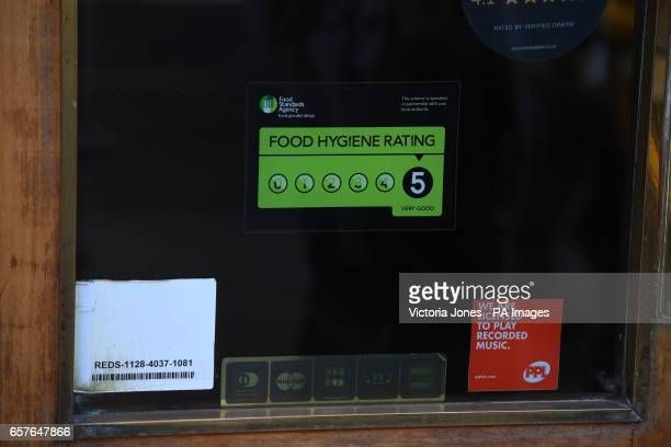 A Food Standards Agency rating sticker on a window of a restaurant in central London A huge variation in food hygiene standards remains across the UK...