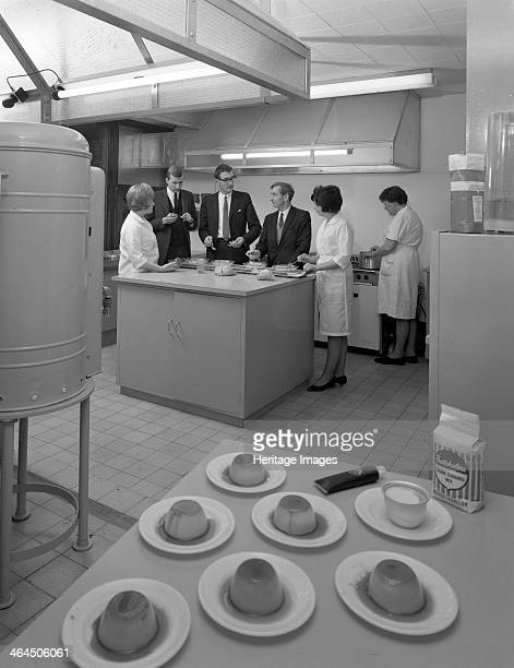 Food tasting in a new experimental kitchen Batchelors Foods Sheffield South Yorkshire 1966 Management sample food prepared at a new experimental...